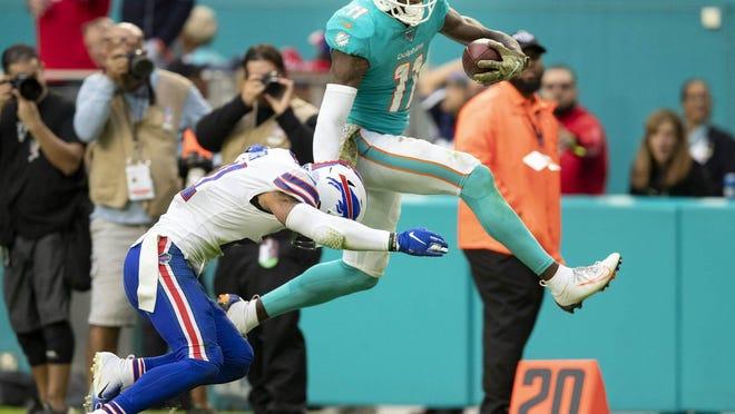 Miami Dolphins wide receiver DeVante Parker hurdles a defender.
