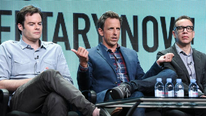 """Executive producer/actors Bill Hader, from left, Seth Meyers, and Fred Armisen speak onstage during the """"Documentary Now!"""" panel at the IFC 2015 Summer TCA Tour held at the Beverly Hilton Hotel on Friday, July 31, 2015, in Beverly Hills, Calif."""