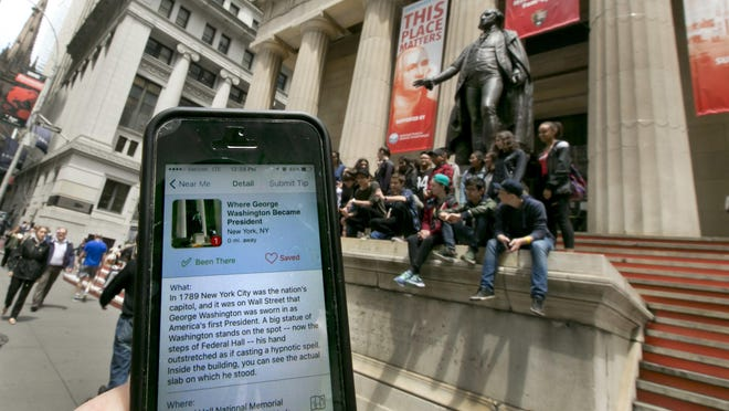 The Roadside Presidents smartphone app directs people to the statue of George Washington on the steps of the Federal Hall National Monument in New York's Financial District.