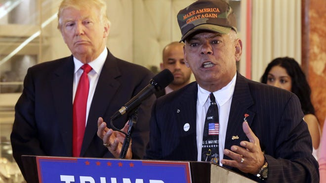 """FILE - In this May 31, 2016, file photo, Republican presidential candidate Donald Trump listens at left as Al Baldasaro, a New Hampshire state representative, speaks during a news conference in New York. Baldasaro said on a Boston radio program on July 19 that Hillary Clinton should be """"put in the firing line and shot for treason,"""" over the Benghazi, Libya, attacks that killed four Americans. (AP Photo/Richard Drew, File)"""