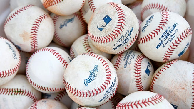 A bucket of baseballs wait to get used for batting practice at the Cleveland Indians baseball spring training facility Tuesday, Feb. 14, 2017, in Goodyear, Ariz. (AP Photo/Ross D. Franklin)