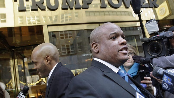 """FILE - In this Nov. 30, 2015, file photo, Pastor Mark Burns, co-founder & CEO of Christian Television Network, from Easley, S.C., right, speaks to the members of the media outside Trump Tower in New York. A few of President Donald Trumpâs leading evangelical supporters defended him after he questioned why the U.S. should accept more immigrants from Haiti and """"s—hole countries"""" in Africa. However, many other evangelicals condemned his remarks, citing their increasing devotion to fellow Christians overseas, along with the large numbers of immigrants in U.S. churches and their families. (AP Photo/Richard Drew, File)"""