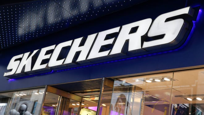 DO NOT PUBLISH THIS IMAGE. USA TODAY / GANNETT DOES NOT HAVE RIGHTS TO PUBLISH THIS IMAGE AFTER JUNE 30, 2015. The outside of a Skechers shoe store is seen at Times Square in New York May 2, 2014. Sport shoes maker Skechers USA Inc said on Friday it will explore buying a stake in the Los Angeles Clippers basketball team, whose owner is at the center of a storm over alleged racist remarks. Skechers said it was consulting with its advisers about leading an investment group to acquire an interest in the team. REUTERS/Shannon Stapleton  (UNITED STATES - Tags: BUSINESS SPORT BASKETBALL) ORG XMIT: SHN602