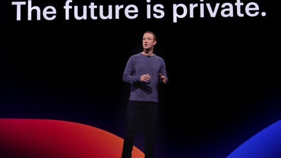 """Mark Zuckerberg on stage in front of """"The future is private."""""""
