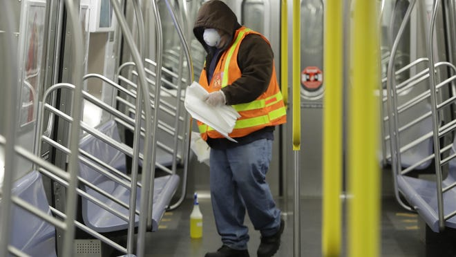 An MTA worker disinfects a train at the Coney Island Stillwell Avenue Terminal, Tuesday, May 5, 2020, in the Brooklyn borough of New York.