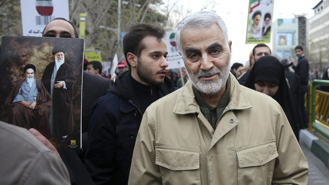 Qassem Soleimani, commander of Iran's Quds Force, attends a 2016 rally in Tehran commemorating the anniversary of the 1979 Islamic revolution. [The Associated Press}