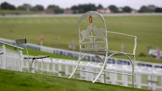 A view of empty seating at Epsom Racecourse, in Epsom, England, Saturday July 4, 2020. The Derby annual horse race will take place at the Epsom Downs Racecourse behind closed doors Saturday amid the coronavirus pandemic. (David Davies/PA via AP)