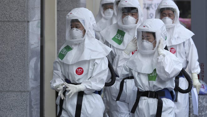 Medical staff members arrive for a duty shift at Dongsan Medical Center in Daegu, South Korea, Wednesday, April 8, 2020. The new coronavirus causes mild or moderate symptoms for most people, but for some, especially older adults and people with existing health problems, it can cause more severe illness or death.
