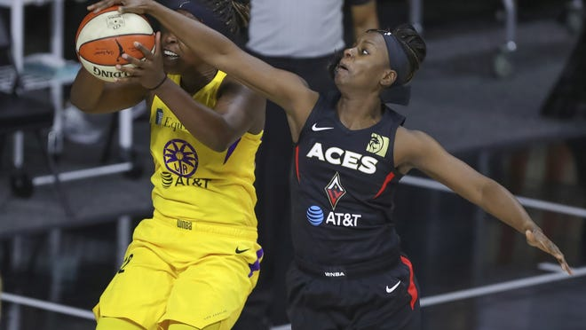 Las Vegas Aces' Sugar Rodgers, right, blocks a shot attempt by Los Angeles Sparks' Chelsea Gray during Saturday's game in Bradenton, Fla. The Aces are the No. 1 seed in the WNBA playoffs, which begin today.