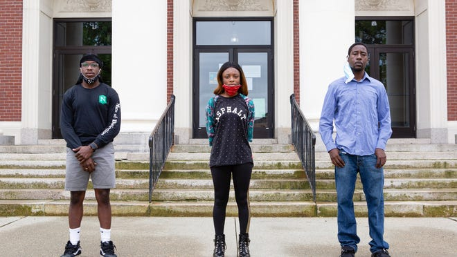 Benjamin Lawson, Abigail Cooper and Jerard Rice stand in front of the Webster Town Hall (from left).