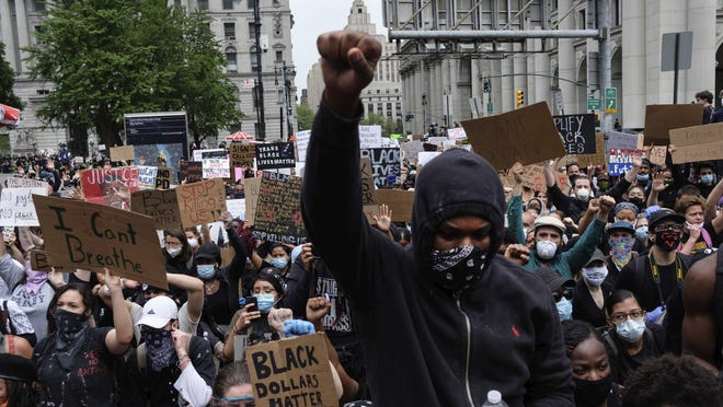 Protesters gather at Foley Square as part of a demonstration to protest the death of George Floyd Tuesday in New York.
