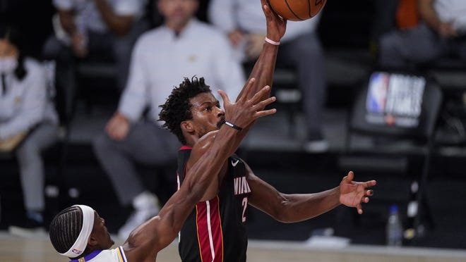 Miami Heat's Jimmy Butler shoots the ball during the second half of Sunday's game.