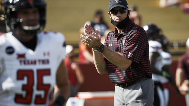 Texas Tech coach Matt Wells exhorts his team before the Red Raiders' 31-15 loss Saturday at Iowa State. The setback made the Red Raiders 1-3 this season, 0-3 in the Big 12 and 5-11 in two years under Wells.