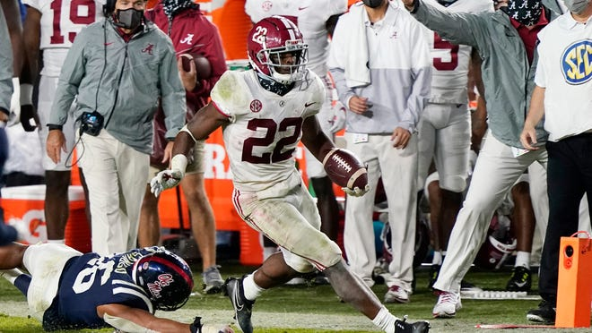 Alabama running back Najee Harris (22) runs past Mississippi linebacker MoMo Sanogo (46) during the second half of an NCAA college football game in Oxford, Miss., Saturday, Oct. 10, 2020. Alabama won 63-48.