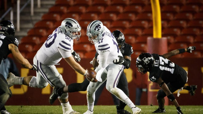 Kansas State quarterback Nick Ast (17) fumbles the ball during the Wildcats' 45-0 loss to Iowa State on Saturday at Jack Trice Stadium in Ames, Iowa.