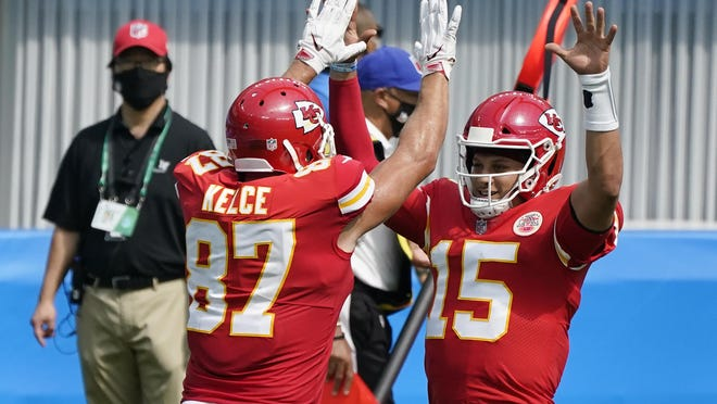 Kansas City Chiefs quarterback Patrick Mahomes (15) celebrates after throwing a touchdown pass to tight end Travis Kelce (87) during the first half Sunday, Sept. 20, in Inglewood, Calif.