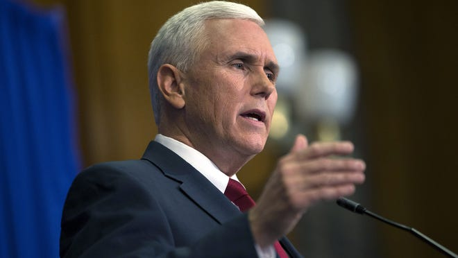 Indiana Gov. Mike Pence speaks during a press conference March 31, 2015 at the Indiana State Library about the state's controversial Religious Freedom Restoration Act, which has been condemned by business leaders and Democrats.