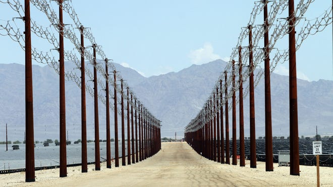 Transmission lines funnel energy from the Desert Sunlight solar farm to the Red Bluff substation near Desert Center, about an hour east of the Coachella Valley, on Aug. 20, 2014.