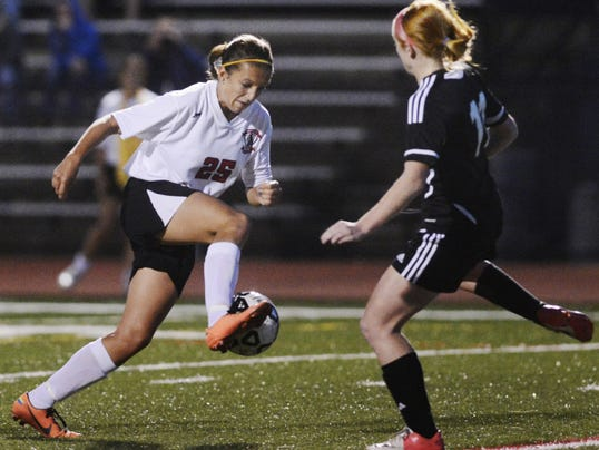 File — GameTimePA.com Dover's Brooke Firestone manuevers past a Northeastern defender to score a goal during her sophomore season in 2013. Firestone has scored 106 goals in her career, including 31 her sophomore season.