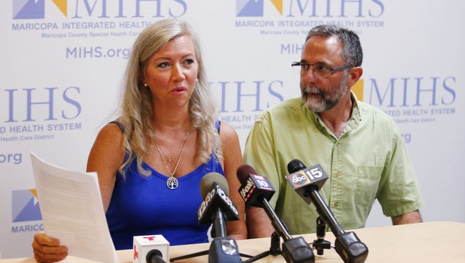 Jan and Bill Kilgore, the parents of Ryan Kilgore, the pilot of the plane that crashed into a home in Gilbert, make a statement at the Maricopa Medical Center on Sept. 20, 2016, in Phoenix.