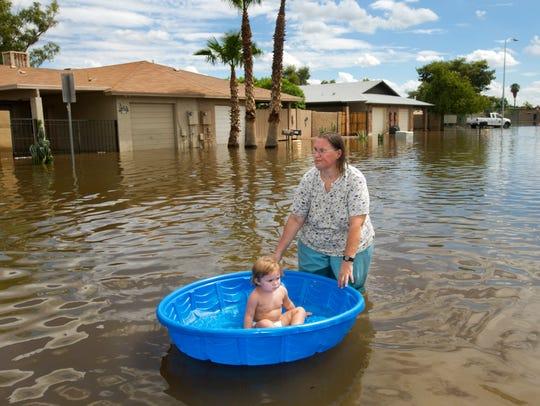 Laura Moravek carries her granddaughter, Alyssa Guarino,