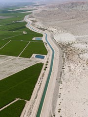 The Coachella branch of the All-American Canal separates farms from open desert in the eastern Coachella Valley on April 15, 2015.