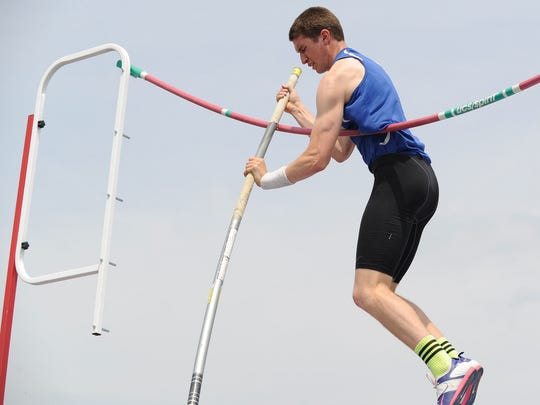 Charter School of Wilmington's Stefano Pineda getting caught on the bar at the state track meet at Dover High School.