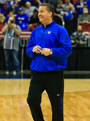 Kentucky head coach John Calipari had smiles to show  during practice at the Louisville Regional Wednesday afternoon. By Matt Stone, The Courier-Journal March 18, 2015