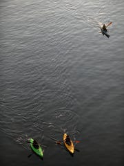 Members of Cincy Paddlers and Tri-State Kayakers had a morning paddle on the Ohio River to watch the summer solstice sunrise and to kick off Paddlefest. 2012.