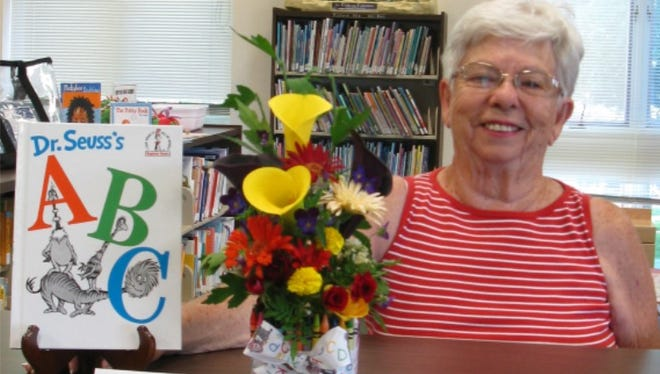 Vee Reifsnyder took second place in a People's Choice Flower Show at Birchard Public Library.