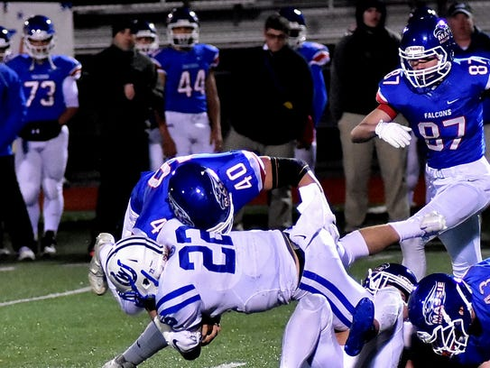 Pierson Rogers (22) lunges out a of the  Clinton-Massie