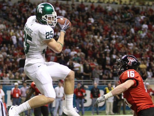 Michigan State's Blair White (25) catches a touchdown