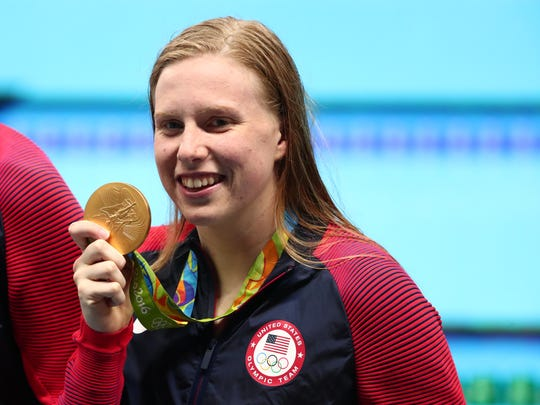 Lilly King (USA) with her gold medal after the women's 4x100m medley relay final in the Rio 2016 Summer Olympic Games at Olympic Aquatics Stadium.
