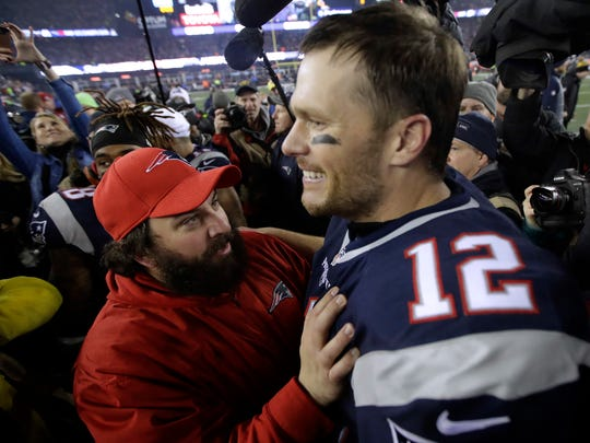 Patriots defensive coordinator Matt Patricia, left, celebrates with quarterback Tom Brady after defeating the Steelers, 36-17, in the AFC championship game Jan. 22, 2017 in Foxborough, Mass.