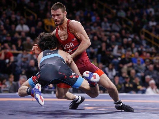 Team USA's Thomas Gilman, right, battles Georgia's