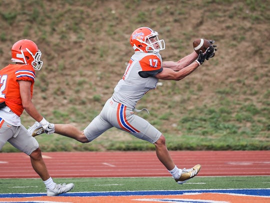 Central's Tanner Dabbert catches the ball for a touchdown during the spring game Friday, May 18, 2018, at San Angelo Stadium.