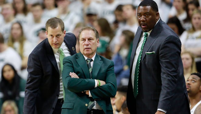 Michigan State's coaches, Tom Izzo (center), Dane Fife (left) and Dwayne Stephens (right) had no answer for Michigan on Saturday. Monday, the Spartans tumbled on many AP poll ballots.