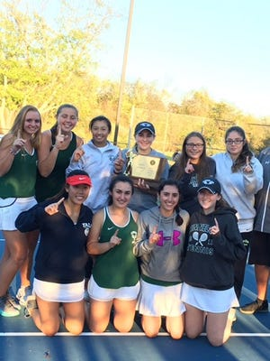 The Kinnelon girls' tennis team proudly displays the NJSIAA Group 1 championship trophy after defeating Morris County rivals Mountain Lakes on Thursday in West Windsor.