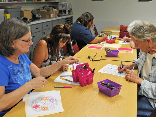 A coloring club for adults meets monthly at the Mims-Scottsmoor