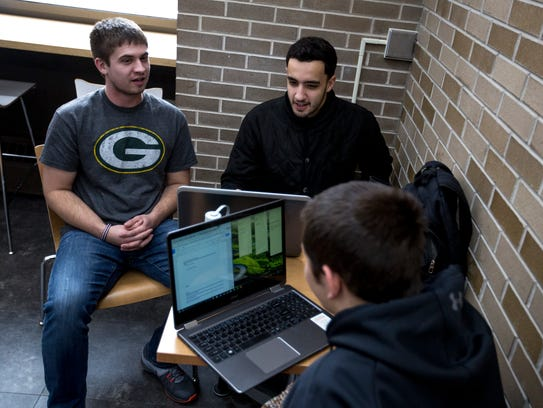 University of Wisconsin-Stevens Point students including Seth Huttner, left, a fifth-year education student, work on a group project on the campus Jan. 9, 2018, in Stevens Point.