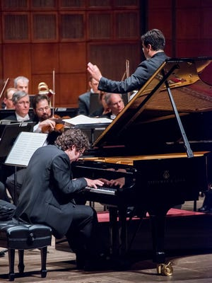Artem Yasynskyy won the finals with the Cincinnati Symphony Orchestra in 2015