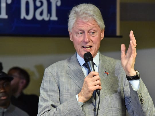 """Former President Bill Clinton, pictured here in 2016 campaigning for his wife and Democratic presidential candidate Hillary Clinton, apologized for his role in the adoption of """"three strikes"""" laws across the U.S."""
