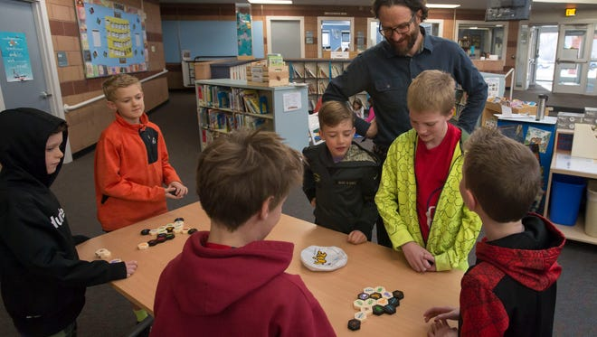 Olander Elementary teacher David Arnoff discusses strategy with students in his gifted and talented enrichment class on Friday, March 9, 2018, at Olander Elementary School in Fort Collins, Colo.