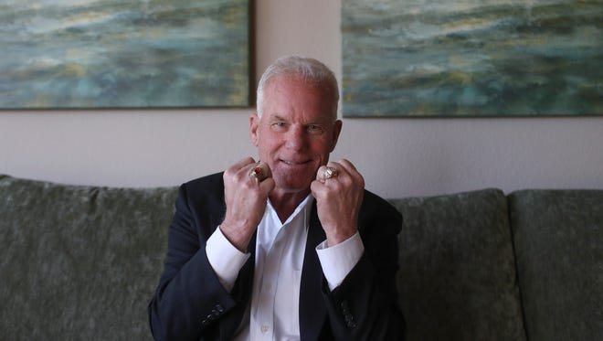 Jeb Allen shows off his rings from winning three world championships in drag racing and being inducted into the International Racing Hall of Fame.