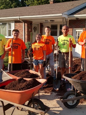 Members of the teen work crew along with Woodville Mayor Rich Harman.