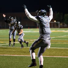 Fort Collins' Kyler Sigsbee celebrates scoring a touchdown during the Windsor versus Fort Collins football game at Rocky Mountain High School in Fort Collins Friday, Sept. 12, 2014. Fort Collins beat Windsor 13-12.