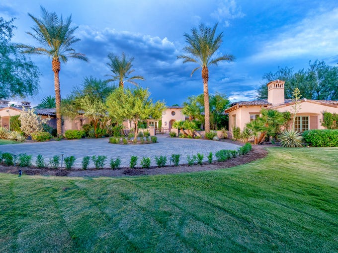 The front yard of the almost 9,500-square-foot home