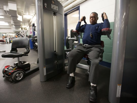 Ronnie Felton works out on an abdominal machine at