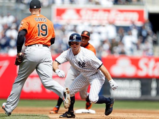 New York Yankees left fielder Brett Gardner (11) gets caught in a rundown against the Baltimore Orioles during the second inning at Yankee Stadium.