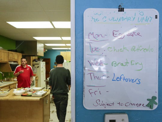FILE - The weekly culinary menu at Painting Pathways Clubhouse April 26, 2018, in Manitowoc. The clubhouse serves lunch daily that is cooked and cleaned by members and offers a food pantry for those who need it.